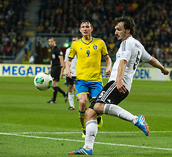 15.10.2013, Friends Arena, Stockholm, SWE, FIFA WM Qualifikation, Schweden vs Deutschland, Gruppe C, im Bild  Germany 5 Mats Hummels Sverige 9 Kim K�llstr�m i duell med/ battles for the ball // during the FIFA World Cup Qualifier Group C Match between Sweden and Germany at the Friends Arena, Stockholm, Sweden on 2013/10/15. EXPA Pictures � 2013, PhotoCredit: EXPA/ PicAgency Skycam/ Peter Werner<br /> <br /> ***** ATTENTION - OUT OF SWE *****