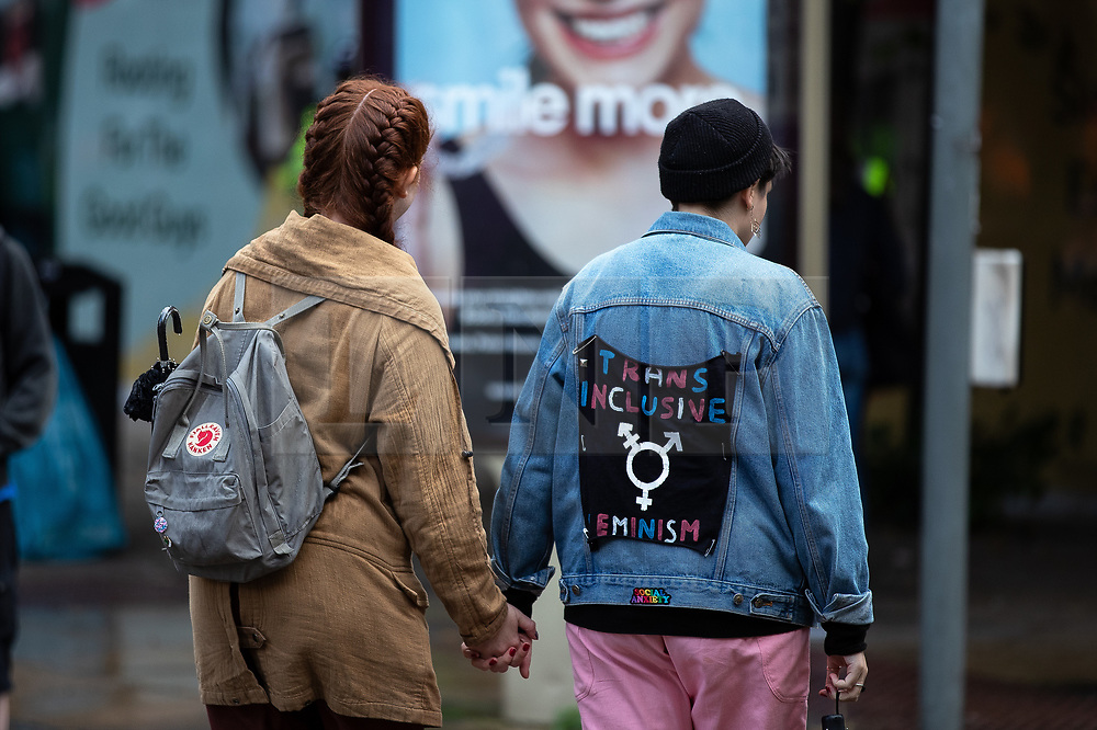 © Licensed to London News Pictures. 01/09/2019. Manchester, UK. A jacket with Trans Inclusive Feminism drawn on the back is seen being warn in Manchester . Extinction Rebellion block roads around Deansgate in Manchester City Centre , during a third day of planned disruption organised by environmental campaigners . Manchester City Council has declared a climate emergency but activists say the council's development plans do not reflect this . Photo credit: Joel Goodman/LNP