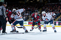 KELOWNA, CANADA - MARCH 10:  Conner Bruggen-Cate #20 and Erik Gardiner #12 of the Kelowna Rockets face off against Nick Chyzowski #16 and Joe Gatenby #37 of the Kamloops Blazers on March 10, 2018 at Prospera Place in Kelowna, British Columbia, Canada.  (Photo by Marissa Baecker/Shoot the Breeze)  *** Local Caption ***