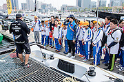 Emirates Team New Zealand's Ray Davies shows local school children over the team's Extreme 40. Day four of the Land Rover Extreme Sailing Series regatta in Qingdao, China. 4/5/2014