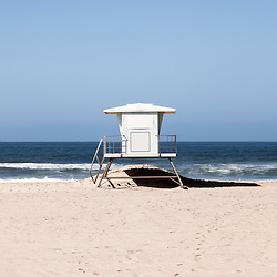 Photo of California lifeguard tower along the Pacific Ocean in Huntington Beach Orange County Southern California.