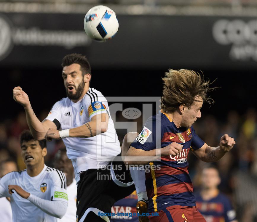 Alvaro Negredo of Valencia Club de F&uacute;tbol and Rakitic of FC Barcelona during the Copa Del Rey match at Mestalla, Valencia<br /> Picture by Maria Jose Segovia/Focus Images Ltd +34 660052291<br /> 10/02/2016