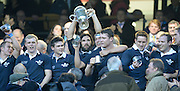 Twickenham. UK.   Oxford's, Captain John Carter hold the trophy aloft, after Oxford win the 2013 Varsity Rugby Match, defeating Cambridge 33 - 15 on    Thursday  12/12/2013, at the RFU Stadium.  Surrey, England  [Mandatory Credit. Peter Spurrier/Intersport Images]