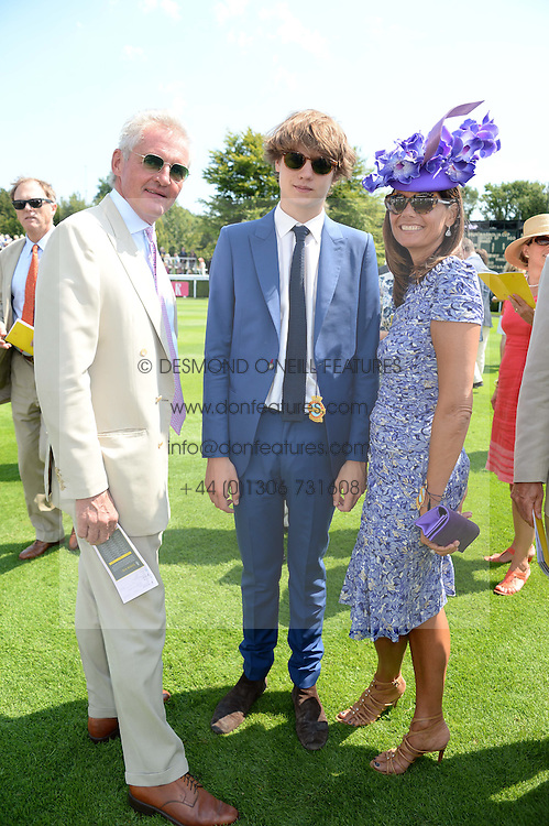 COUNT & COUNTESS LEOPOLD VON BISMARCK and their son SASHA VON BISMARCK at the 3rd day of the 2013 Glorious Goodwood racing festival - Ladies day at Goodwood Racecourse, West Sussex on 1st August 2013.