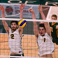 2nd year middle blocker Conal McAinsh (2) of the Regina Cougars and 2nd year Right-Side hitter Matthew Aubrey (7) of the Regina Cougars  in action during the Women's Volleyball Home Game vs U of C Dinos on October21 at the CKHS University of Regina. Credit Arthur Ward/©Arthur Images 2017