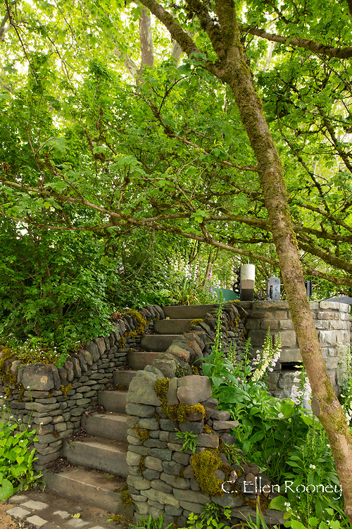 Stone steps leading to the lock gate at the Welcome to Yorkshire Garden at the RHS Chelsea Flower Show 2019, London, UK