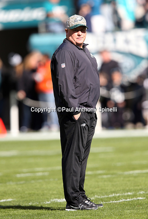 Philadelphia Eagles head coach Chip Kelly watches pregame warmups before the 2015 week 10 regular season NFL football game against the Miami Dolphins on Sunday, Nov. 15, 2015 in Philadelphia. The Dolphins won the game 20-19. (©Paul Anthony Spinelli)