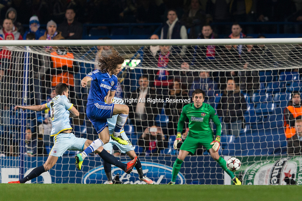 11.12.2013 London, England.  Chelsea's David LUIZ gets a shot in during the Champions League group E game between Chelsea and Steaua Bucharest from Stamford Bridge.