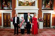 AMSTERDAM - King Willem-Alexander, Queen Maxima, President Halimah Yacob of the Republic of Singapore and her husband Mohamed Abdullah Alhabshee in the Royal Palace prior to the state banquet. The state visit confirms the good and close bilateral relations between the Netherlands and Singapore and is aimed at further strengthening and deepening cooperation.  copyright robin utrecht