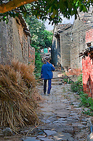 The ancient village of Yangmei is approximately 30 kilometres from the provincial capital of Nanning.  A local resident strolling one of the ancient laneways in Yangmei.