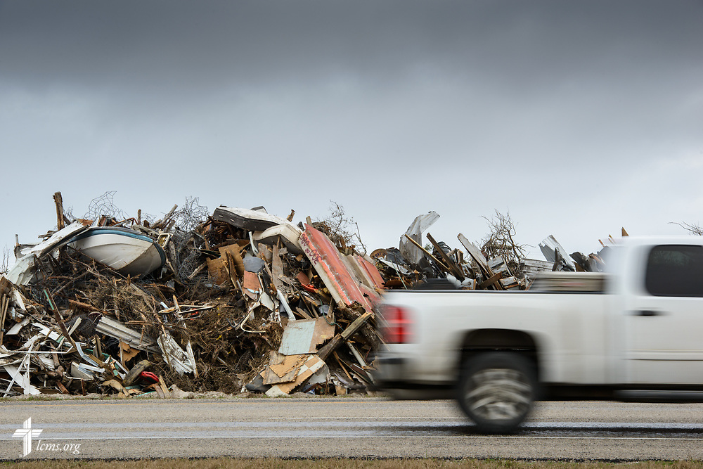 Debris from Hurricane Harvey is piled between a roadway on Tuesday, Feb. 6, 2018, near Rockport, Texas. Recovery work is still underway almost six months after the hurricane devastated parts of Texas.  LCMS Communications/Erik M. Lunsford