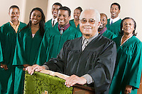 Minister at podium with Gospel Choir portrait