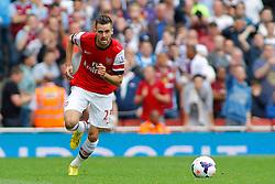 Arsenal's Carl Jenkinson runs with the ball  - Photo mandatory by-line: Mitch Gunn/JMP - Tel: Mobile: 07966 386802 17/08/2013 - SPORT - FOOTBALL - Emirates Stadium - London -  Arsenal V Aston Villa - Barclays Premier League