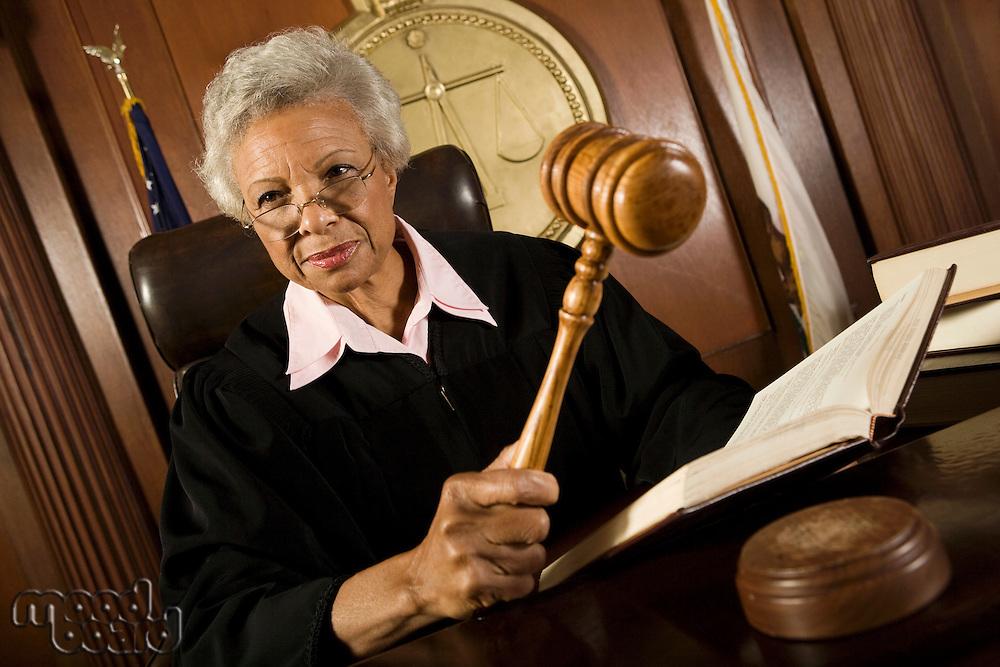 Female judge holding hammer in court