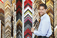 Portrait of a happy young man with multi colored frames in background