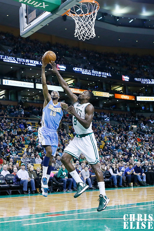 10 February 2013: Denver Nuggets small forward Corey Brewer (13) goes for the layup against Boston Celtics power forward Jeff Green (8) during the Boston Celtics 118-114 3OT victory over the Denver Nuggets at the TD Garden, Boston, Massachusetts, USA.
