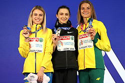 Ukraine's Yuliya Levchenko (left), Mariya Lasitskene, and Lithuania's Airine Palsye with their medals at the Women's High Jump Final during day three of the European Indoor Athletics Championships at the Emirates Arena, Glasgow.