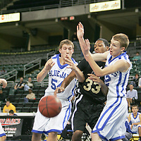 Center Jared Walde (54) and guard Matt McCarthy (12) try to stop a Ucity player from grabbing the rebound.
