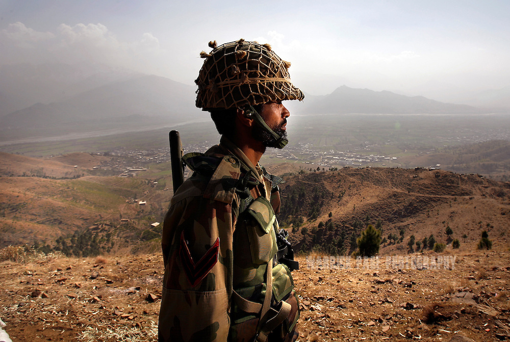SWAT VALLEY, PAKISTAN - FEBRUARY 25: A Pakistani soldier stands guard at a military outpost on a strategic mountain-top in Pajia on Monday, February 25, 2008, Swat Valley, Pakistan. The Pakistan Army has spent more than three months battling Islamic militants in the Swat Valley, reclaiming large swaths of land, but failing to drive completely the militants from its mountainous landscape. Once a major tourist destination, the Swat valley was overrun last year with Islamic militants intent on imposing hard-line Islamic rule. In November, 2007, the military staged one of its largest operations since its six-year involvement in the war on terror to drive the militants out. Pakistan's ongoing commitment to fighting Islamic militancy and terrorism is unclear with the formation of a new government after recent national elections. . (Photo by Warrick Page)