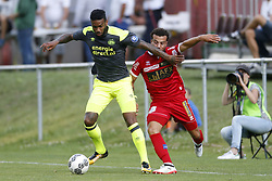 (L-R), Jurgen Locadia of PSV, Nicolas Luchinger of FC Sion during the friendly match between FC Sion and PSV Eindhoven at Stade St-Marc on July 12, 2017 in Bagnes, Switzerland