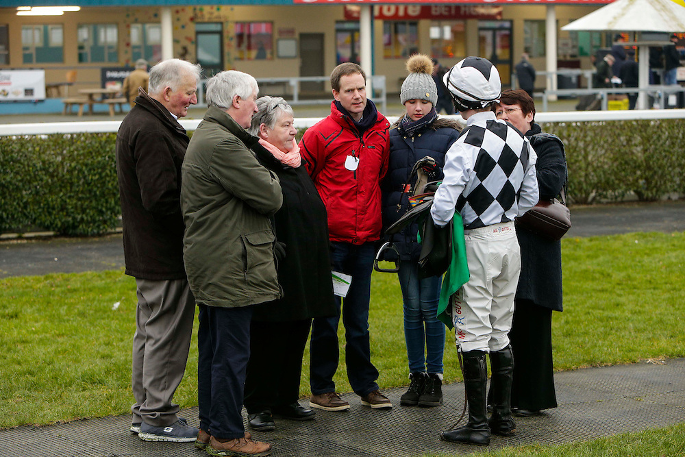 Navan Races, Saturday 27th February 2016.<br /> Trainer Thomas Gibney (Red Jacket) discusses the race with jockey Jonathon Moore after the Follow Navan on Facebook Steeplechase<br /> Photo: David Mullen /www.cyberimages.net / 2016