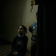 Picture taken on december 22nd 2013 of two syrian children refugees in their appartment in Irbid.