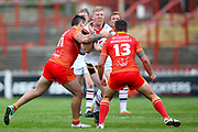 Bradford Bulls prop Liam Kirk (8) is tackled during the Kingstone Press Championship match between Sheffield Eagles and Bradford Bulls at, The Beaumont Legal Stadium, Wakefield, United Kingdom on 3 September 2017. Photo by Simon Davies.