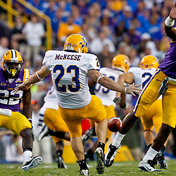 October 16, 2010; Baton Rouge, LA, USA; LSU Tigers defensive end Barkevious Mingo (49) nearly blocks a punt by McNeese State Cowboys punter Ben Bourgeois (23) during the first half at Tiger Stadium.  Mandatory Credit: Derick E. Hingle