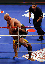 August 2, 2007; East Rutherford, NJ, USA; The Silverbacks Gerald Harris (Yellow Trunks) is knocked out in the first round by the Anacondas Benji Radach (Green Trunks) during their semifinal bout at the Continental Airlines Arena in East Rutherford, NJ.