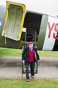 Cecil Hughs, 9 Para, exits a dakota. Veterans of the Parachute Regiment at the time of D Day, in the second world war, visit 16 Air Assault Brigade who will be carrying out a drop to commemorate the 70th anniversary next week. Colchester, UK.
