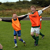 Eric Copley and Michael Bonfil celebrating a goal at the Moneypoint FC Summer Soccer Camp in Kilrush on Wednesday.<br /> Photograph by Yvonne Vaughan