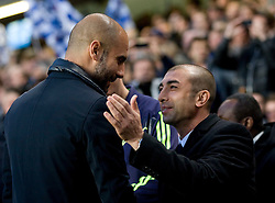 18.04.2012, Stamford Bridge, London, ENG, UEFA CL, Halblfinal-Hinspiel, FC Chelsea (ENG) vs FC Barcelona (ESP), im Bild Roberto Di Matteo Manager fo Chelsea (left) shakes hands with Barcelona's Manager Josep Guardiola (right) during the UEFA Championsleague Halffinal 1st Leg Match, between FC Chelsea (ENG) and FC Barcelona (ESP), at the Stamford Bridge, London, Great Britain on 2012/04/18. EXPA Pictures © 2012, PhotoCredit: EXPA/ Propagandaphoto/ Tim Hales     / ATTENTION - OUT OF ENG, GBR, UK *****