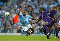 Photo. Aidan Ellis.<br />Manchester City v Tottenham Hotspur.<br />FA Barclaycard Premiership.<br />28/09/2003.<br />City's Trevor Sinclair is fouled by Spurs Anthony Gardener