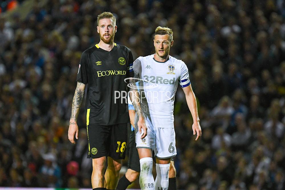 Brentford defender Pontus Jansson (18) and Leeds United defender Liam Cooper (6) during the EFL Sky Bet Championship match between Leeds United and Brentford at Elland Road, Leeds, England on 21 August 2019.