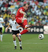 Wayne Ronney and  Philipp Lahm (li, Deutschland) during the 2010 World Cup Soccer match between England and Germany in a group 16 match played at the Freestate Stadium in Bloemfontein South Africa on 27 June 2010.