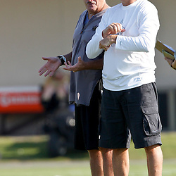 July 29, 2012; Metairie, LA, USA; New Orleans Saints assistant head coach and linebackers coach Joe Vitt talks with general manager Mickey Loomis on the sideline during a training camp practice at the team's practice facility. Mandatory Credit: Derick E. Hingle-US PRESSWIRE
