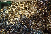 Colorful metal shavings on the workshop floor in the De Lijn tram depot Gentbrugge, Ghent, Belgium.