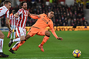 Liverpool forward Roberto Firmino (9) plays a through ball tracked by Stoke City midfielder Joe Allen (4) 0-1 during the Premier League match between Stoke City and Liverpool at the Bet365 Stadium, Stoke-on-Trent, England on 29 November 2017. Photo by Alan Franklin.