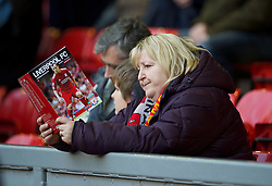 LIVERPOOL, ENGLAND - Boxing Day Monday, December 26, 2011: A Liverpool supporter reading the match-day programme before the Premiership match against Blackburn Rovers at Anfield. (Pic by David Rawcliffe/Propaganda)