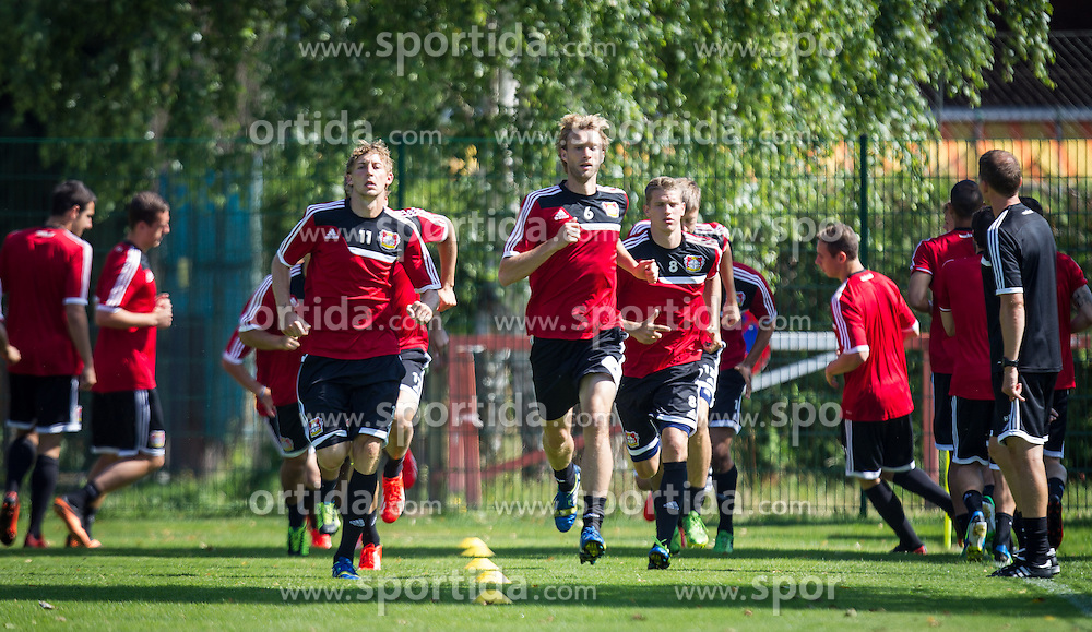 17.07.2013, Alois Latini Stadion, Zell am See, AUT, Bayer 04 Leverkusen Trainingslager, im Bild beim Warmlaufen, Stefan Kiessling, (Bayer 04 Leverkusen), Simon Rolfes, (Bayer 04 Leverkusen) und Lars Bender, (Bayer 04 Leverkusen) // during a Trainingssession of the German Bundesliga Club Bayer 04 Leverkusen at the Alois Latini Stadium, Zell am See, Austria on 2013/07/17. EXPA Pictures © 2013, PhotoCredit: EXPA/ Juergen Feichter