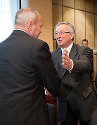 Jean-Claude Juncker, Luxembourg's prime minister, and president of the Eurogroup, right, greets Franc Krizanic, Slovenia's finance minister, during the meeting of European Union finance ministers in Brussels, Belgium, on Monday, May 17, 2010. (Photo © Jock Fistick)