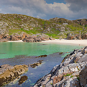"""Achmelvich,(Gaelic: Achadh Mhealbhaich) is a settlement situated in the Highland region of Scotland. The name comes from the Gaelic """"Achadh"""" - a plain or meadow and """"mealvaich"""" - sandy dunes."""