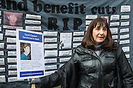 Standing against a banner naming people who have dies after benefits cuts a woman displays a placard telling the tragic story of her brother's circumstances during a benefits sanctions protest at Department of Work and Pensions, Westminster.<br /> Picture by Paul Davey/Focus Images Ltd +447966 016296<br /> 09/03/2016