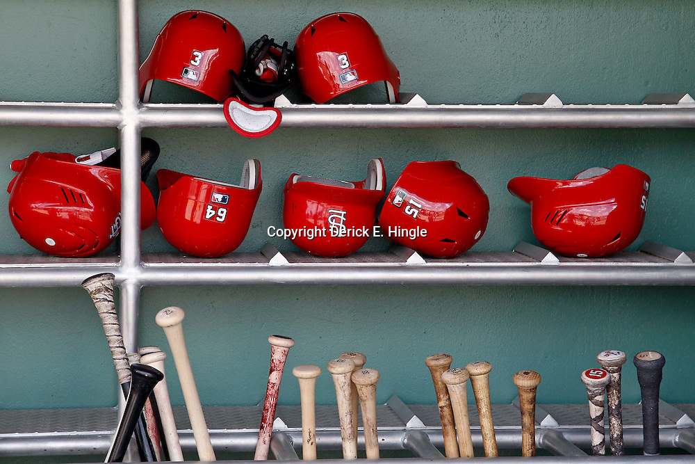 March 15, 2012; Fort Myers, FL, USA; A detail of St. Louis Cardinals batting helmets and bats in the dugout before a spring training game against the Boston Red Sox at Jet Blue Park. Mandatory Credit: Derick E. Hingle-US PRESSWIRE