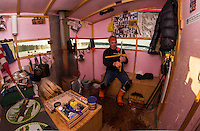 Rick Barton of Belmont checks over a tip up in his Bob House on Saunders Bay as he readies for the annual Great Rotary Fishing Derby this weekend.  (Karen Bobotas/for the Laconia Daily Sun)