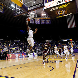 Jan 5, 2013; Baton Rouge, LA, USA; LSU Tigers guard Anthony Hickey (1) lays the ball in past Bethune-Cookman Wildcats forward Adrien Coleman (1) during the second half of a game at the Pete Maravich Assembly Center. LSU defeated Bethune-Cookman 79-63. Mandatory Credit: Derick E. Hingle-USA TODAY Sports