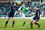 Jason Naismith (#3) of Ross County heads the ball away from the outstretched leg of Anthony Stokes (#28) of Hibernian during the Ladbrokes Scottish Premiership match between Hibernian and Ross County at Easter Road, Edinburgh, Scotland on 23 December 2017. Photo by Craig Doyle.