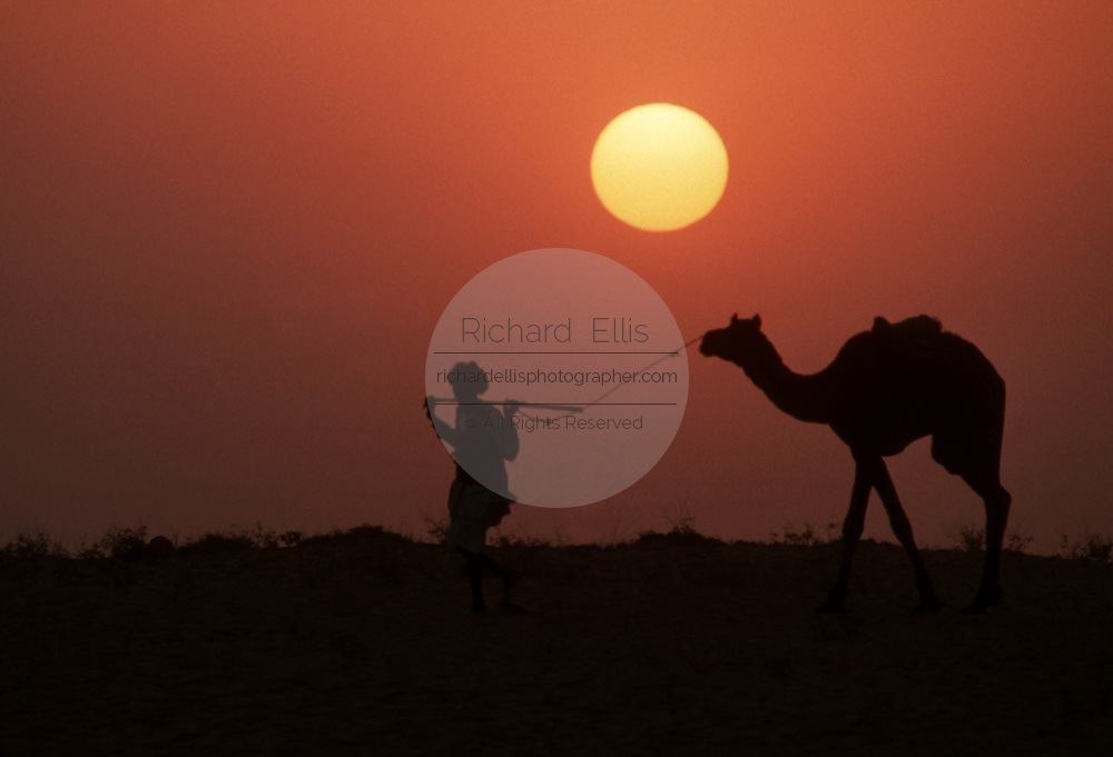 Nomads gather at the Pushkar Camel Fair in the desert of Rajasthan, India.