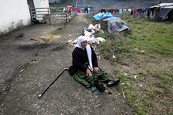 A woman sits on the ground at the Greece-Former Yugoslav Republic of Macedonia (FYROM) buffer zone on March 18, 2016. More than 45,000 people are stranded in Greece after Macedonia shut its border. EXPA Pictures © 2016, PhotoCredit: EXPA/ Photoshot/ Marios Lolos<br /> <br /> *****ATTENTION - for AUT, SLO, CRO, SRB, BIH, MAZ, SUI only*****