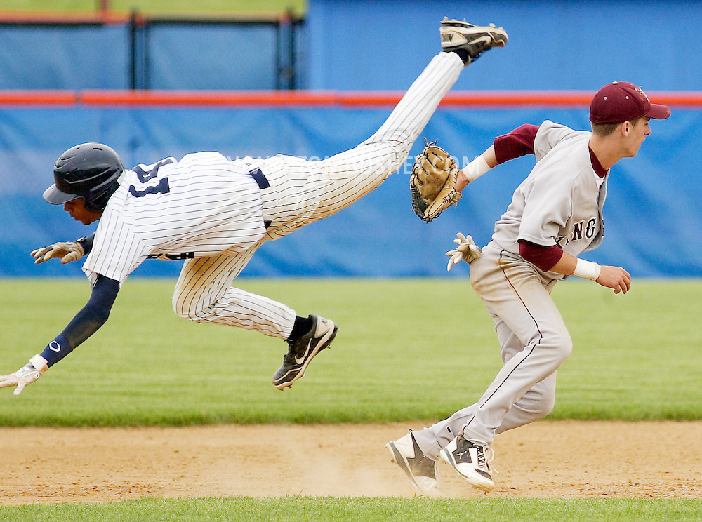 Kingston shortstop Zach Short, right, upends Pine Bush baserunner Keith Bjaelker during the Section 9 Class AA baseball championship game at SUNY New Paltz on Friday June 1, 2012.